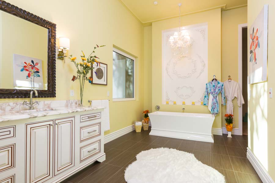 Yellow master bathroom on Adams Road brings the feng shui element of happiness