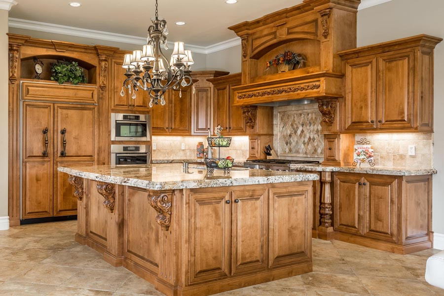 Alder wood custom cabinets shout luxury in this Chef's kitchen.