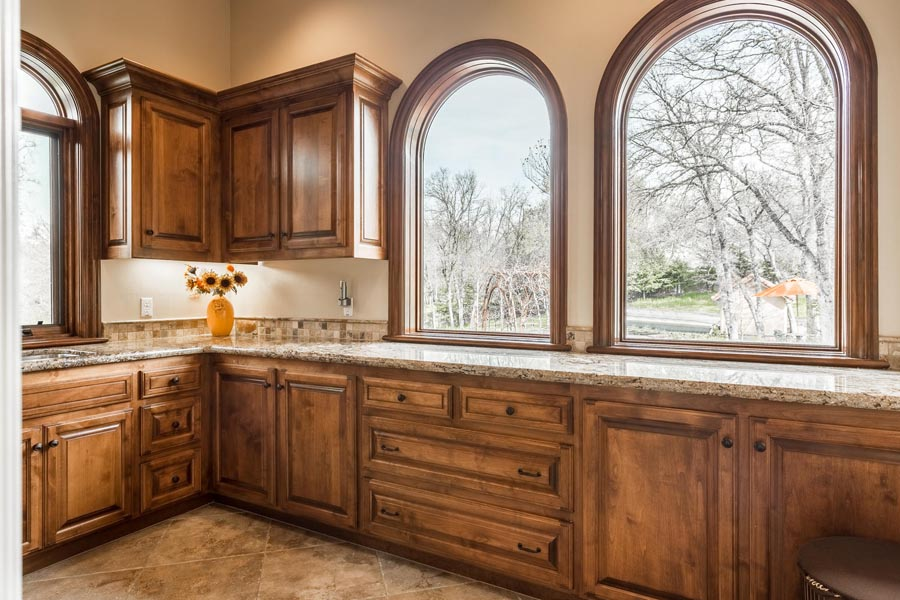 Laundry room with lots of windows and alder wood cabinets.