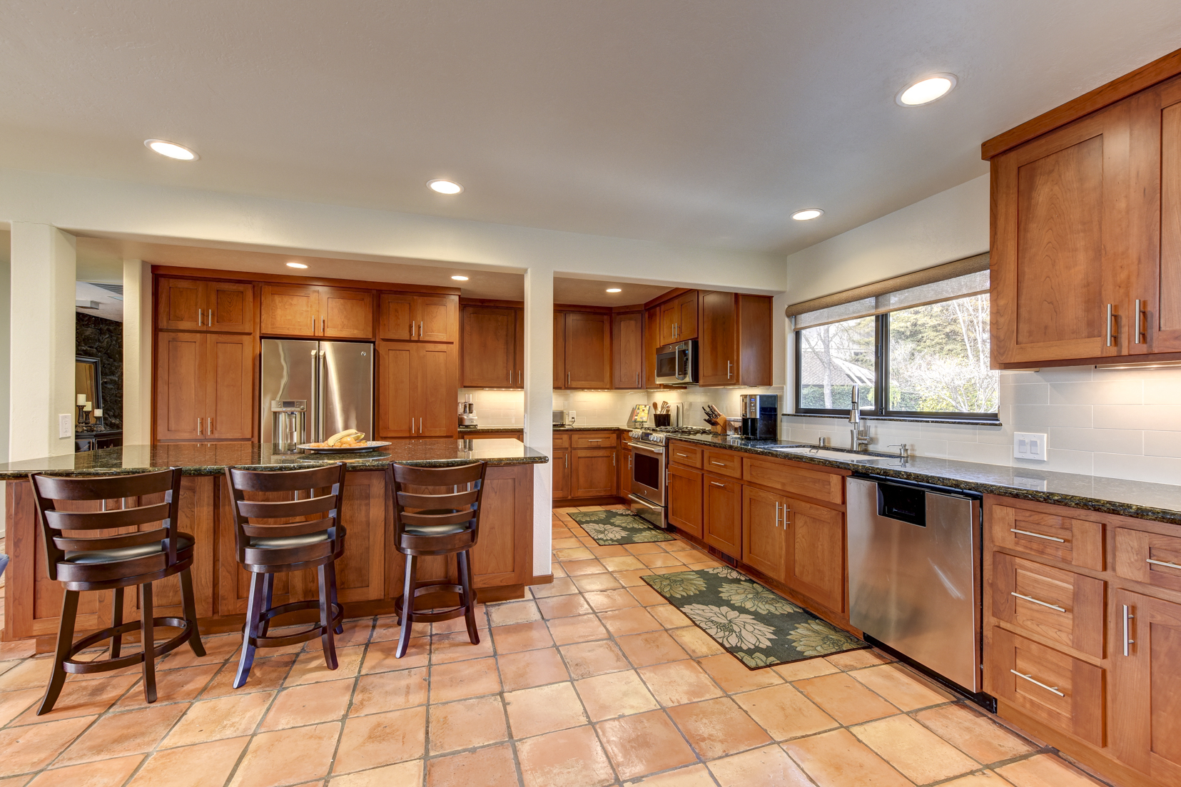 Updated cherry cabinet kitchen with stainless steel appliances