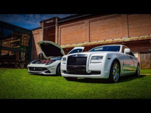 Video thumbnail for Poker Run youtube video showing a ferrari F12 and Rolls Royce Ghost in white